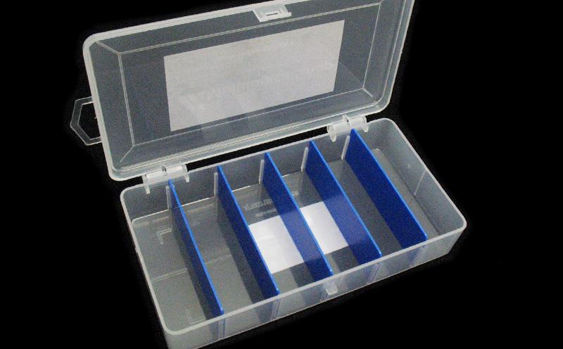 Caixa para componentes com divisória móvel